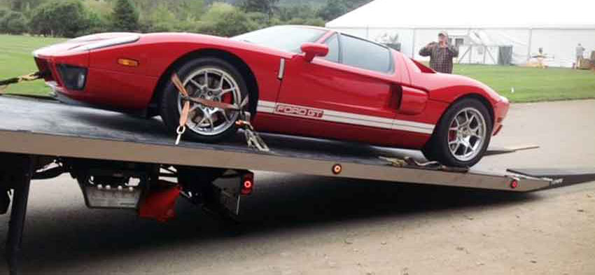 Protect your sports car with a flatbed tow truck!